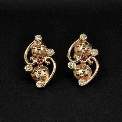 Orecchini in oro rosa 375, con brillanti e rubini